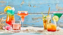 Exotic Summer Drinks On White Sand