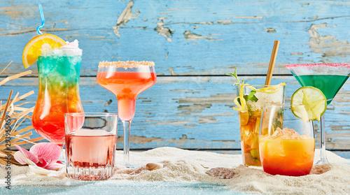 Obraz na plátně Exotic summer drinks on white sand