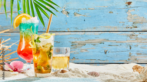 Fototapeta Tropical cocktails in beach decorations