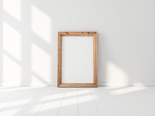 Vertical Wooden Poster Frame Mockup Standing Near White Wall