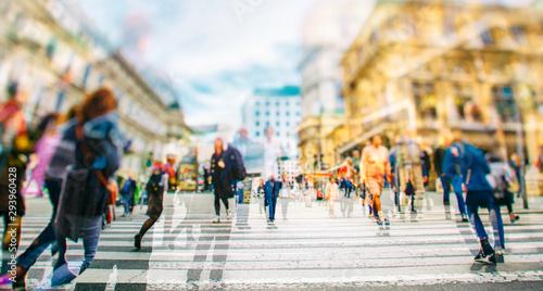 Fototapeta Crowd of anonymous people walking on busy city street obraz