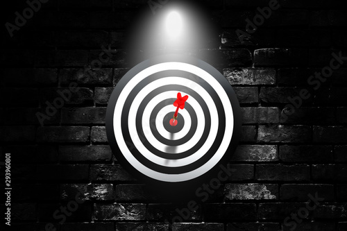 Business Marketing and Planning Concept : Red dart hit target on dartboard that hanging on black brick wall Wallpaper Mural