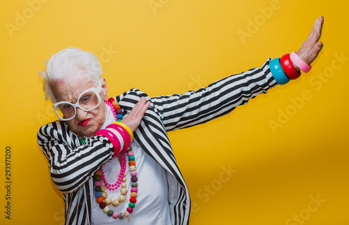 Funny grandmother portraits. Senior old woman dressing elegant for a special event. granny fashion model on colored backgrounds - 293971200