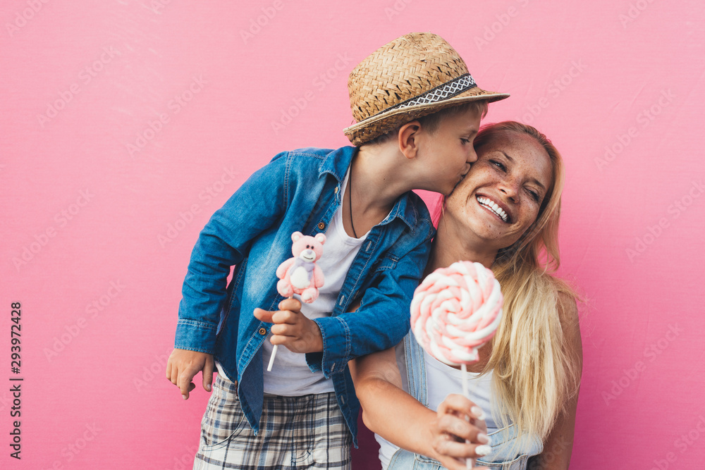 Fototapety, obrazy: Beautiful mother and son on colored backgrounds