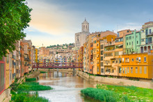 Girona Colorful Houses District, Bridge, And Saint Mary Cathedral, Buildings Reflected In Water In River Onyar. Catalonia Spain.
