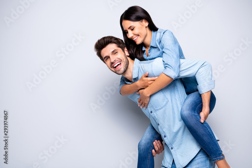 Profile photo of funny guy and lady holding piggyback playing leisure game rejoi Wallpaper Mural