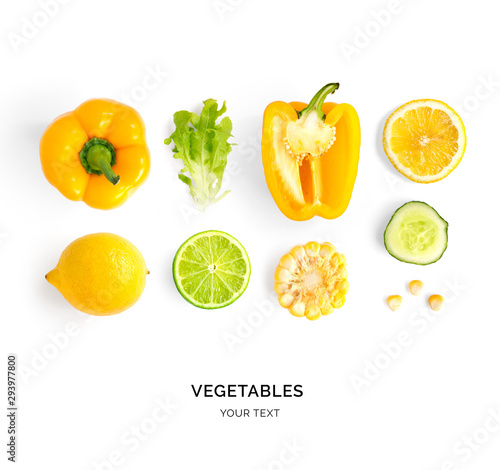 Obraz na plátne Creative layout made of yellow pepper, lemon, lime, corn and lettuce