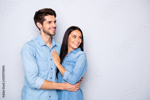 Photo of charming cheerful cute nice couple of people looking away at empty blan Canvas-taulu