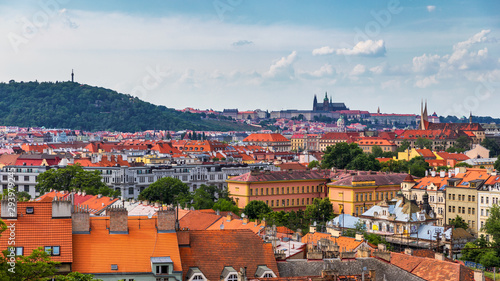 Poster Prague View of Prague Castle over red roof from Vysehrad area at sunset lights, Prague, Czech Republic. Scenic view of Prague city, Prague castle and Petrin tower from Vysehrad overlooking red roofs