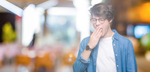 Young Handsome Man Wearing Glasses Over Isolated Background Bored Yawning Tired Covering Mouth With Hand. Restless And Sleepiness.