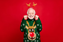 Photo Of Funny Santa Man With Pretty Horns On Head Celebrating Newyear Surprise Visit From Children Wear Stylish X-mas Ugly Ornament Sweater Isolated Red Background