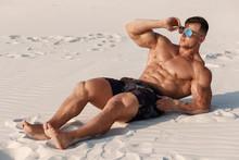 Muscular Man On The Beach Enjo...