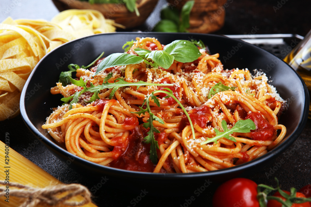 Fototapety, obrazy: Plate of delicious spaghetti Bolognaise or Bolognese with savory minced beef and tomato sauce garnished with parmesan