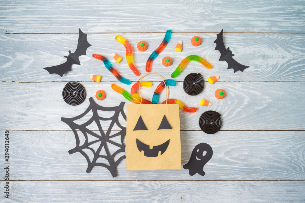 Fototapety, obrazy: Halloween holiday party background with gift paper bags and candy .Top view from above. Flat lay