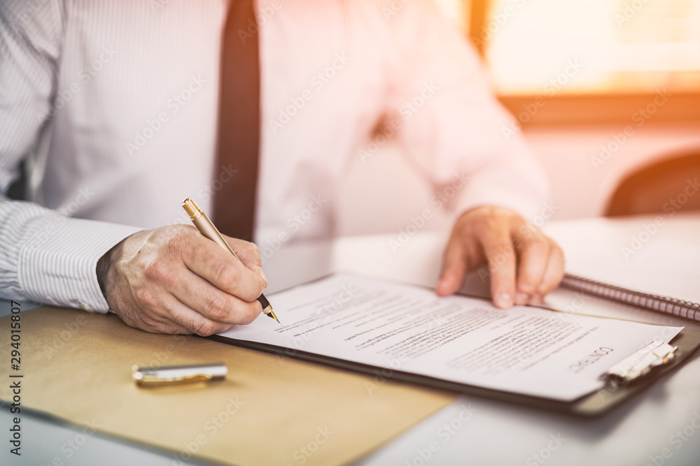 Fototapeta Business man signing contract, making a deal.