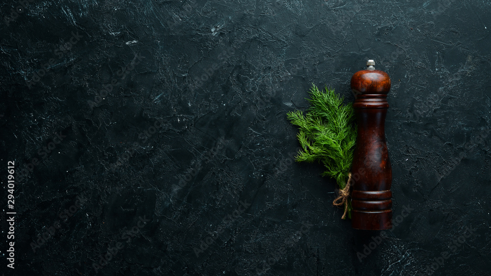 Fototapety, obrazy: Fresh green dill on a black stone background. Top view. Free space for your text.