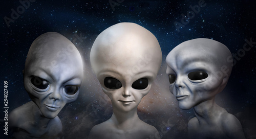 Photo Three different grey aliens on the background of cosmic sky and galaxy