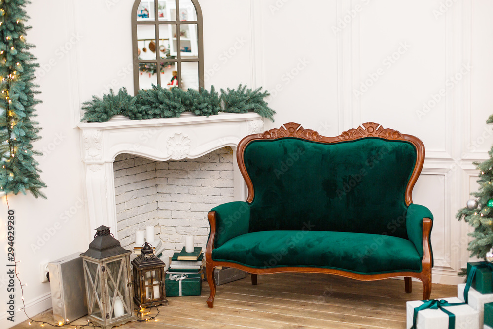 Fototapety, obrazy: Elegant Interior with green sofa and fireplace decorated for celebrating New Year. Comfort home in Christmas Holidays