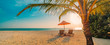 canvas print picture - Beautiful tropical sunset scenery, two sun beds, loungers, umbrella under palm tree. White sand, sea view with horizon, colorful twilight sky, calmness and relaxation. Inspirational beach resort hotel
