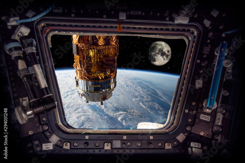 spaceship next to the earth and the moon Elements of this image furnished by NA Wallpaper Mural