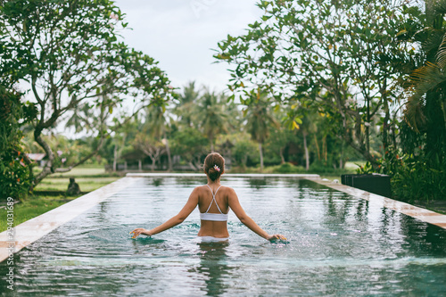 Infinity pool with a view on palm trees, Ubud, Bali Canvas Print