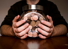 Hands Holding A Jar Of Money 1p And 2p, Saving Up, Business, Glass Jar.