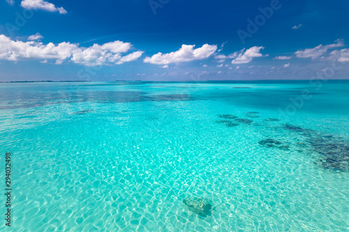 Foto auf Leinwand Turkis Tropical sea under the blue sky. Perfect sky and water of ocean