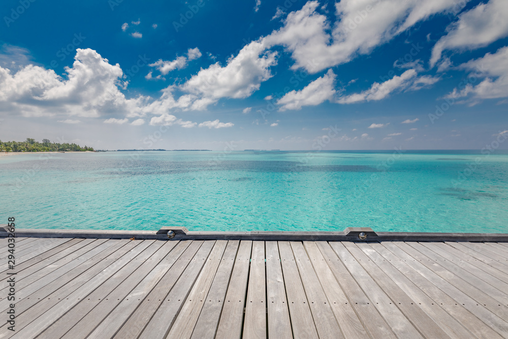 Fototapeta Beautiful beach with water bungalows and old wooden pier at Maldives