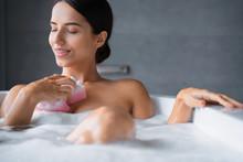 Joyful Woman Washing Herself U...
