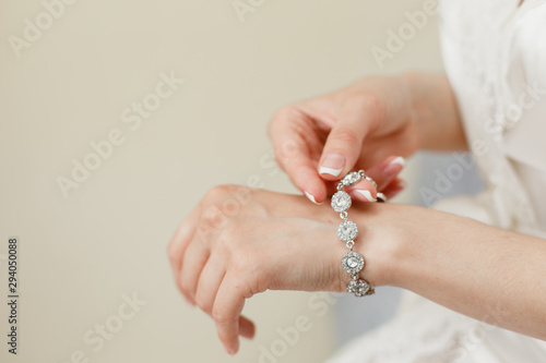 Tableau sur Toile Woman's hands with perfect manicure with silver bracelet