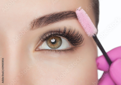 Beautiful Woman with long eyelashes in a beauty salon Wallpaper Mural