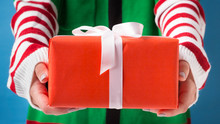 Santa's Helper Delivering Holiday Presents For Children