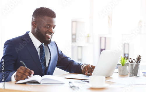 Cheerful young manager making market research online Canvas-taulu