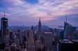 Beautiful New York city skyline view at dawn. Magical purple unset sky over Empire State building.