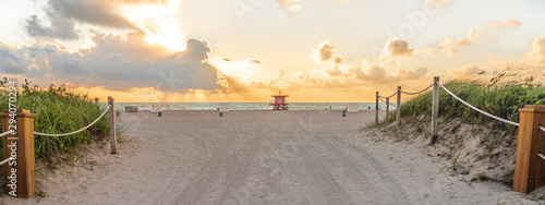 Pathway to the beach in Miami Beach Florida with ocean background at sunrise