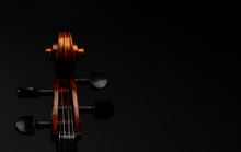 A Close Up High Resolution Image Of A Cello Scroll, Peg Box, And Tuning Pegs Isolated Against A Black Background