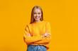 Leinwandbild Motiv Beautiful young girl posing to camera with folded arms