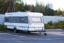 Movable Property. Old Abandoned Motor Mobile Home For Traveling, Trailer, Caravan Parked In A Parking Lot.