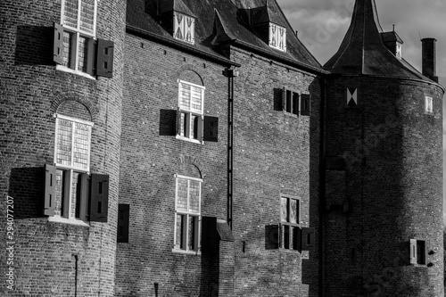 Facade of a Brick European Medieval - 12th Century - Castle in Black and White Fototapet