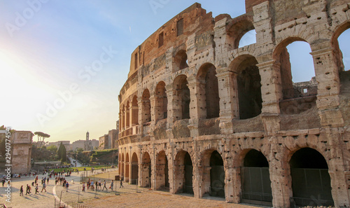Valokuvatapetti FLAVIAN THEATRE, ROME, ITALY - 2018: Many people gather at the Colosseum entrance at sundown