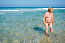 An Elderly Man With Flippers R...