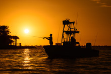 Man Silhouette Fishing On A Boat