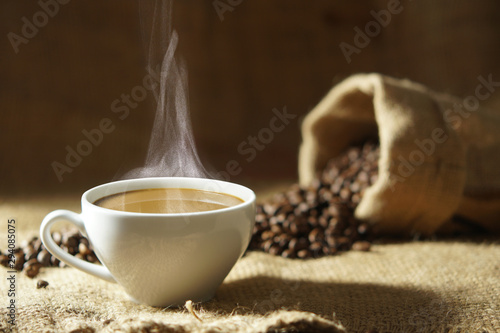 Cadres-photo bureau Café en grains white coffee cup with hot steam smoke and roasted coffee beans around