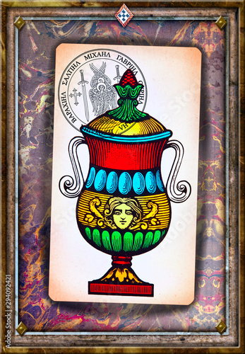 Ace of tarot cups on a background of esoteric cards, and astrological and alchemical symbols