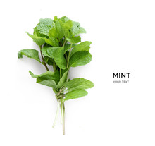 Creative Layout Made Of Mint. Flat Lay. Food Concept. Vegetables Isolated On White Background.