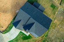 Aerial Top Down View Of A Hip And Valley Pitched Roof On A New Construction American Luxury Single Family House Real Estate