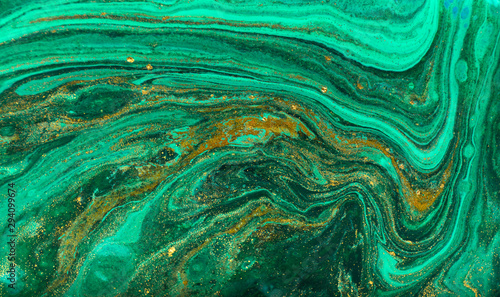 Green and gold ripple of agate background. Golden powder marble texture.
