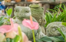 Frog Statue In The Flower Garden