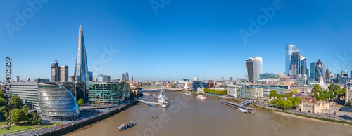 Poster London Aerial cityscape panorama of the Thames river on a sunny day with the City Hall, Shard skyscraper and London City Financial district skyline.