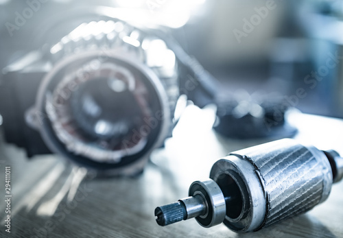 Fotografie, Obraz  Close-up of iron industrial motor lies on a table